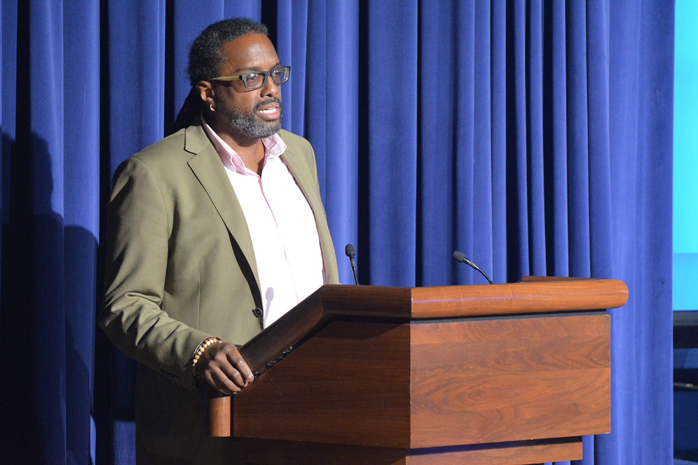 """Khafre ABif read his piece, """"You Are the Brave,"""" centering on HIV and AIDS in the bisexual community and the resilience of bi people."""